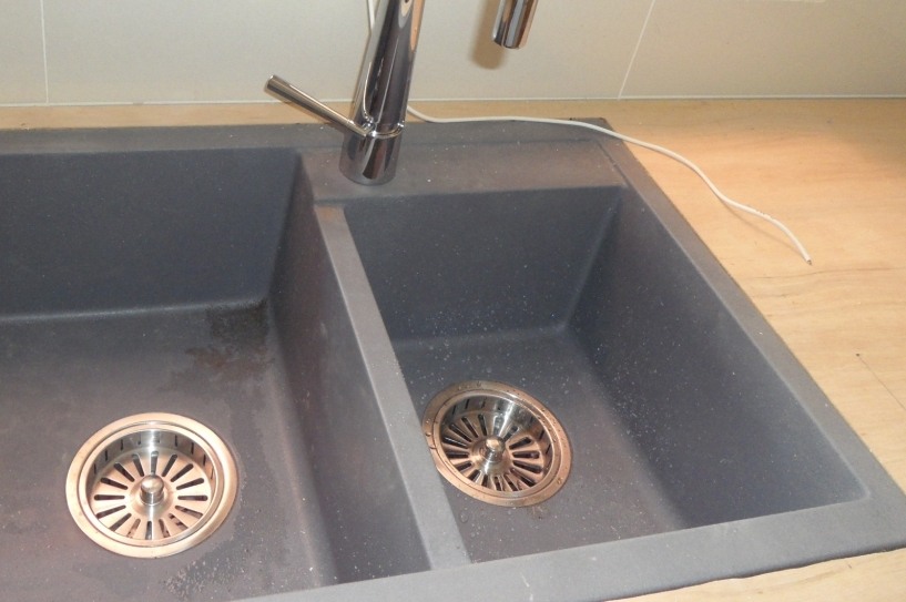 as you can see the sink is mounted like a top mount on the wooden